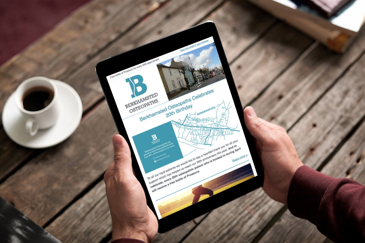 reading berkhamsted osteopaths newsletter on an ipad